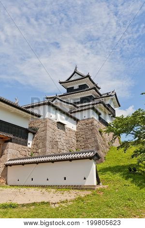 SHIRAKAWA JAPAN - JUNE 2 2017: Reconstructed Main Keep (donjon) of Shirakawa (Komine) Castle Japan. Castle was founded in 1340 rebuilt in 1627 destroyed in war of 1868 and reconstructed in 1991