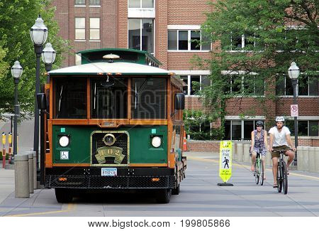 Minneapolis, Minnesota - July 8, 2015: a bus and two bicyclists in University of Minnesota