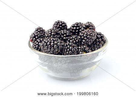 Fresh blackberries in a glass bowl.Isolated on white background.