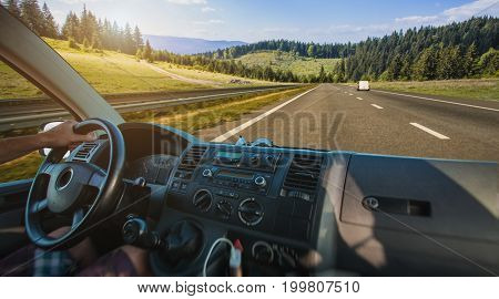 Car dashboard and steering wheel inside of car. Travel in the mountains