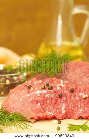 Raw Meat With Spices And Vegetables Ready For Cooking