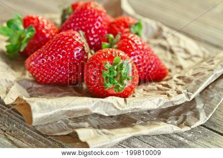 fresh strawberries closeup on wooden background