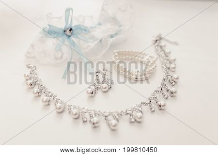 Luxury wedding jewelry and garter on a white background