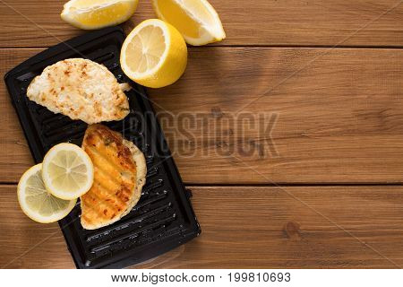 Halloumi roasted on grill cypriot cheese on wood, top view