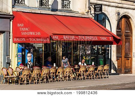 Paris France - June 19 2017: A traditional restaurant Rallye-Tournelle in Paris on the Tournelle Quay. Parisians and tourists enjoy food and drinks on the terrace in the summer day.