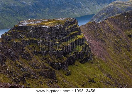 Majestic Mountain Ridge On Overcast Day In Scottish Highlands