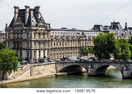 Paris France - July 05 2017: View of the Louvre Museum (Musee du Louvre) and Pont Royal bridge over Seine River. Louvre Museum is one of the largest and most visited museums worldwide.