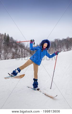 smiling happy young woman skier in winter forest