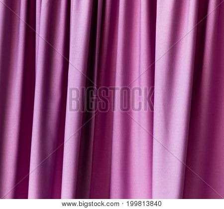 Purple cloth on the curtain as a background .