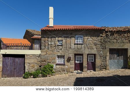 Traditional house made of stone in the historic village of Castelo Mendo in Portugal; Concept for travel in Portugal