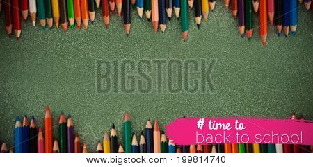 Back to school text with hashtag  against overhead view of colored pencils on gray table
