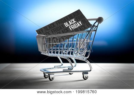 Black friday concept. Grand sale after Thanksgiving. Online shopping, e commerce and internet store concept. Miniature shopping cart with www letters.