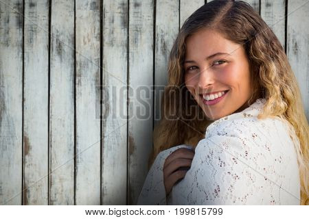 Portrait of beautiful brunette woemn against wood background