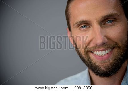 Portrait of handsome man against dark grey background