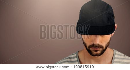 Portrait of man wearing black hat  against brown background