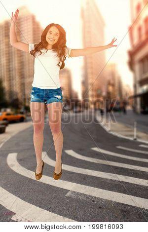 Pretty brunette jumping  against new york street