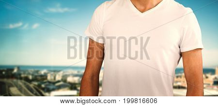 Midsection of model against white background against cityscape against sky