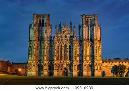 West front of Cathedral Church of Saint Andrew at night. The Wells Cathedral was built between 1175 and 1490.