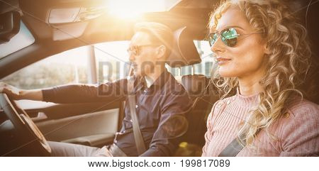 Couple driving car during test drive