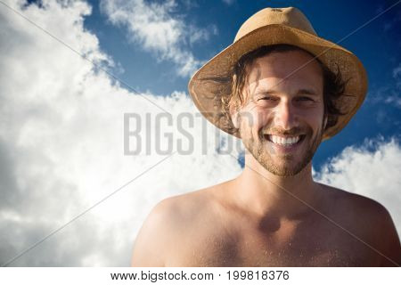 Handsome man wearing hat  against view of beautiful sky and clouds
