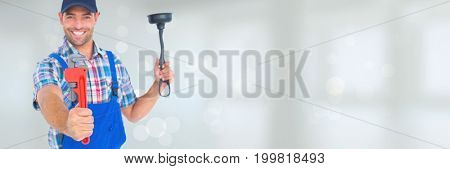 Digital composite of Happy plumber man holding a plunger and a wrench against white background with flares