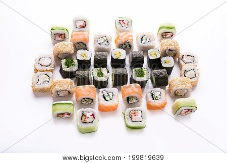 Traditional japanese restaurant food. Colorful vegetable and fish rolls closeup at white. Big party sushi set, pov, sushi assortment background