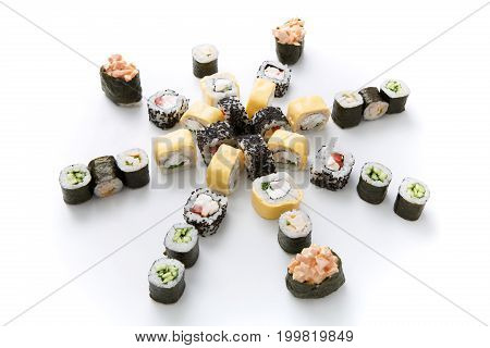 Sushi assortment isolated on white background. Big set of vegetable and fish rolls covered with nori, cheese and sesame. Japanese food delivery