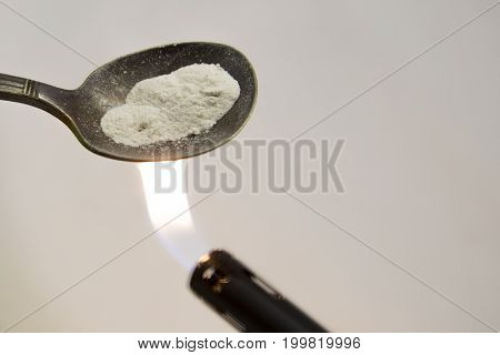 Heroin In Spoon With Lighter