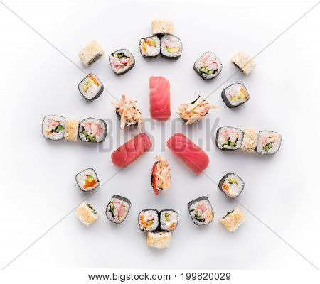 Big party sushi set isolated on white background. Japanese food delivery and take away. Fish and vegetable rolls, tuna nigiri and spicy gunkans