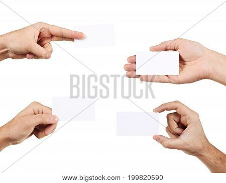 Male hand holding a business card, close up