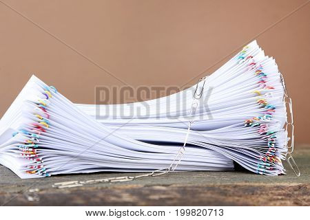 Stack Of Papers With Paperclips On Wooden Table