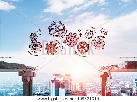 Sketched gear mechanism over gap in concrete bridge as symbol of teamwork and problem solving. Cityscape and sunlight on background. 3D rendering.