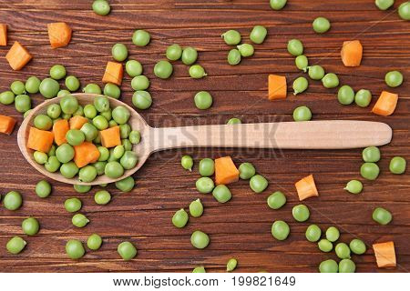 Green Peas And Carrots Sliced On Cutting Board