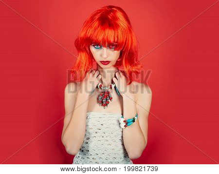 Woman In Red Wig With Fashionable Makeup.