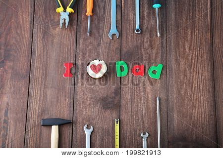 Different Tools For Fathers Day On Brown Wooden Table