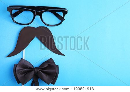 Bow Tie Mustache And Glasses On Blue Background