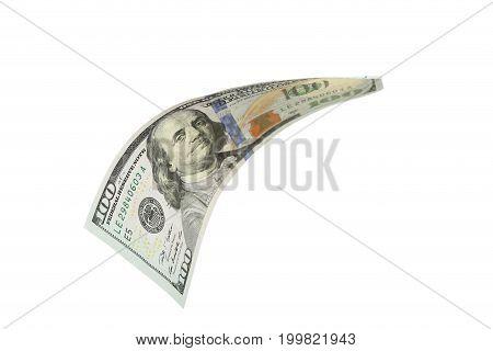 Hundred dollar bill falling on white background