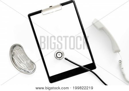 Call doctor. Phone, clip pad and cuvette with ampoulie on white background top view.