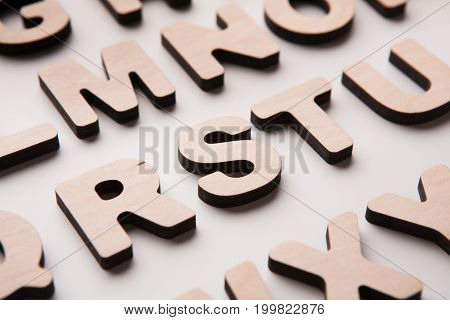 Wooden english letters background. Alphabet study, abc, education concept