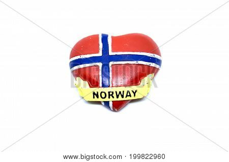 Kota Kinabalu Malaysia - August 15 2017: Norwegian flag with heart shape fridge souvenir from Norway.