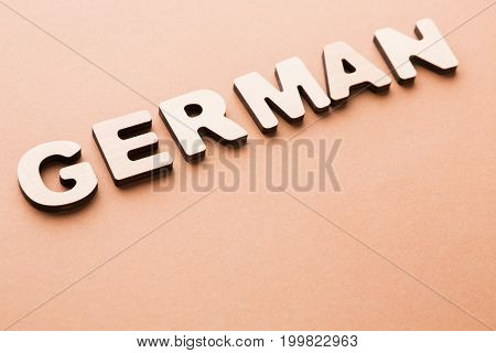 Word German on beige background. Foreign language learning, education concept