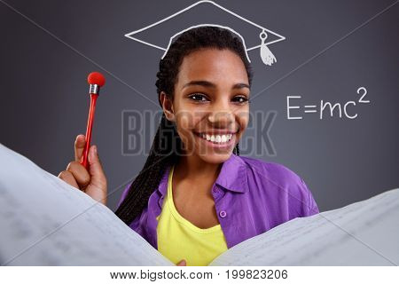 Education in school - happy schoolgirl doing math equations