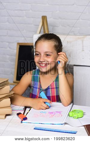 Kid And School Supplies On White Brick Background, Defocused