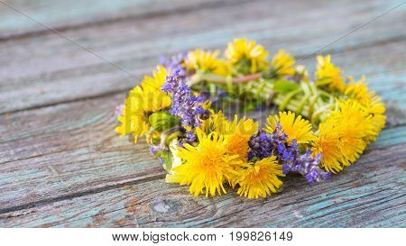 Dandelion Bouquet On An Old Wooden Background.