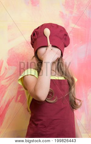 Girl Cook Hiding Face With Chef Hat And Wooden Spoon