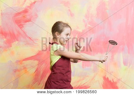 Small Girl On Colorful Background.