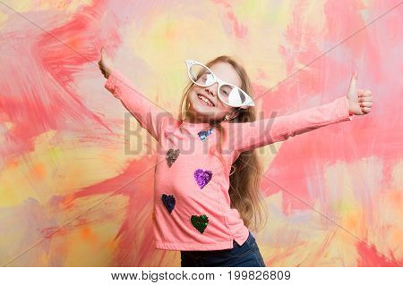Girl In Funny Eyeglasses Smiling With Two Thumbs Up