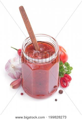 tomato sauce in glass jar on white background