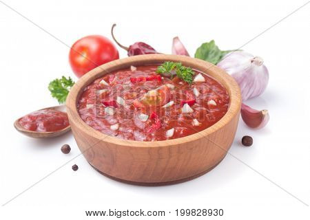 tomato sauce in gravy boat on white background