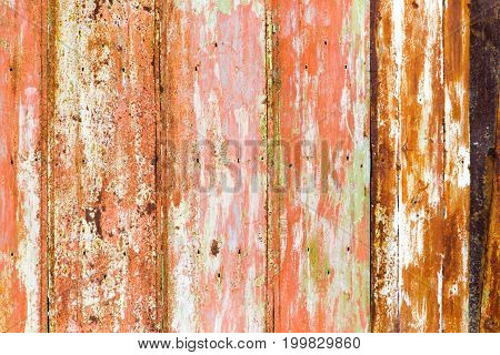 Old rusty metal fence as an abstract background .
